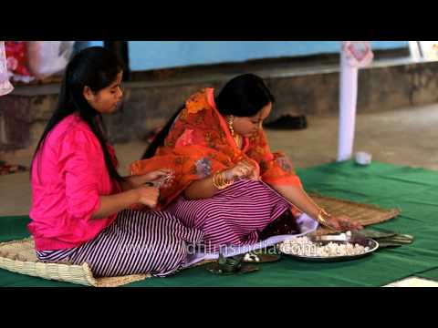 Manipuri bride making garland for wedding