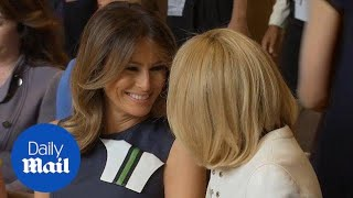 Melania Trump chats cheerfully with Brigitte Macron in Brussels