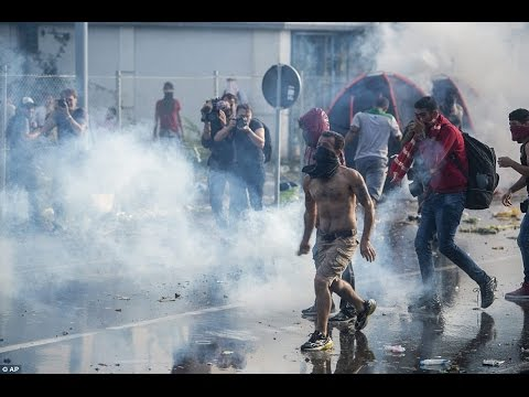Hungary police fire tear gas shells at migrants at border