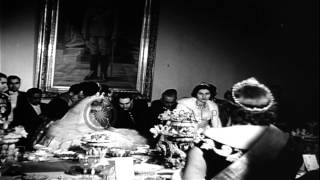 The Shah of Iran, Mohammed Reza Pahlevi, and his bride at their wedding reception...HD Stock Footage
