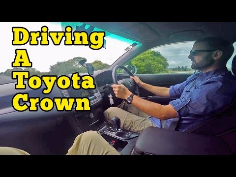Driving a Toyota Crown on Maraetai Cost Road, New Zealand
