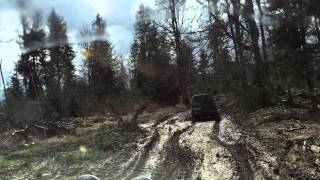 Mitsubishi Pajero and Nissan Patrol on a  muddy road
