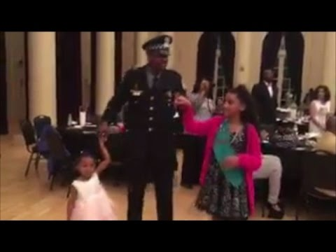Police Officers Escort Girls Without Fathers to Annual Daddy Daughter Dance