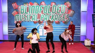 Fans Dance It Out During 'Blindfolded Musical Packages'