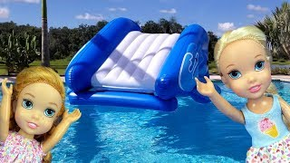 Water Slide ! Elsa and Anna toddlers - pool playdate - Barbie - floaties - swim - water fun - splash
