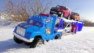 Cars for kids riding through the snow then transported by truck