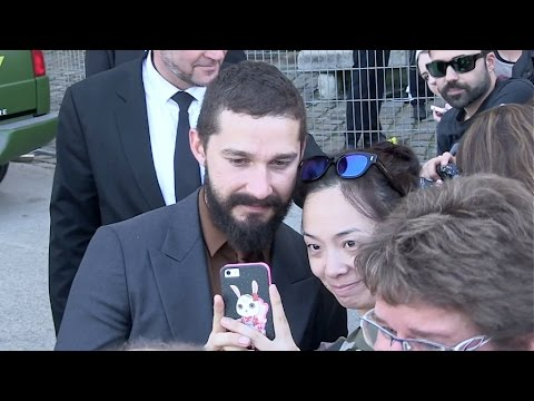 Shia LaBeouf greets fans at Fury Photocall in Paris