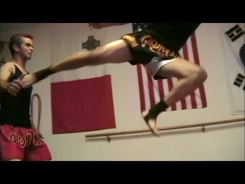 Kung Fu Sanshou vs Muay Thai Fight Scene Image 1