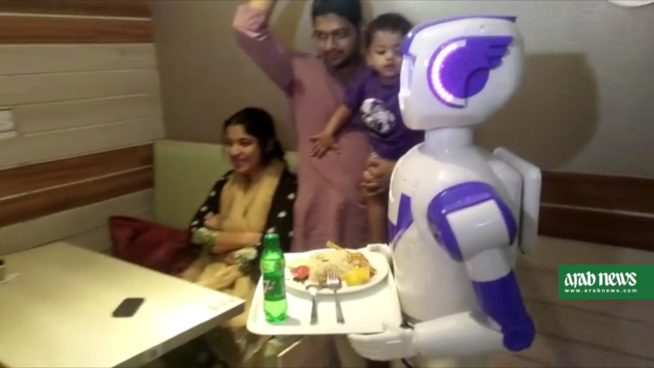 Customers revel as robot waiters serve at Dhaka restaurant