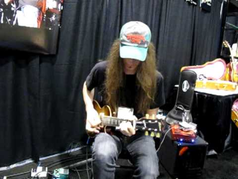 Scotti Hill from Skid Row noodling on a HiStrung Octave at 2012 NAMM