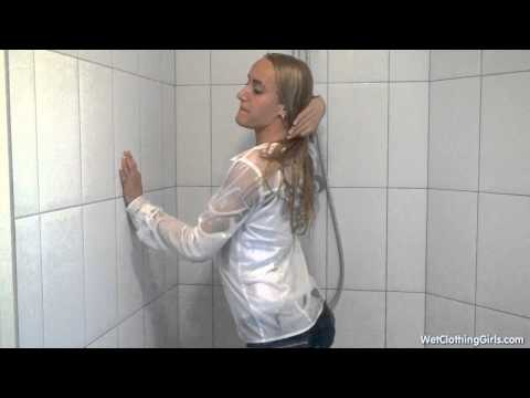WetClothingGirls: Paula in white blouse and tight jeans takes a shower