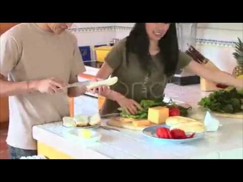 Happy Young Asian Couple Preparing Food In Kitchen. Stock Footage