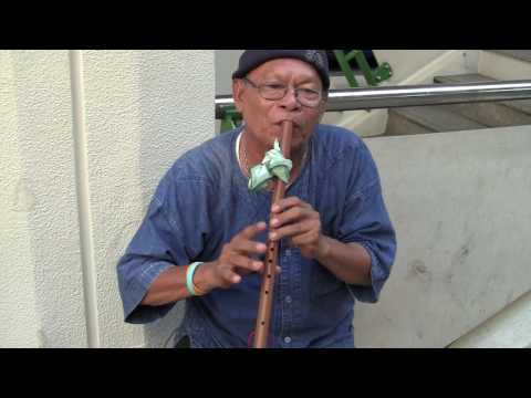 Beautiful  traditional Thai  flute music played on the street