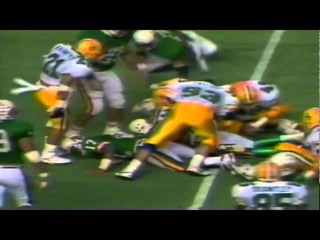 Oregon DT David Cusano shuts down Hawaii QB Warren Jones on a run 12-03-1988