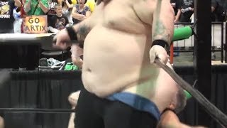Wrestler Attempts to Smother Opponent
