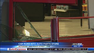 Car runs into auto parts store