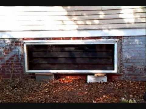 Passive solar horizontal crawl space heater. solar energy. recycled materials