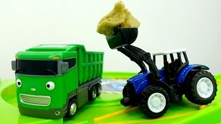 Helper Cars: a toy tractor and toy truck.
