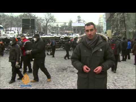 Ukraine police dismantle protest camps