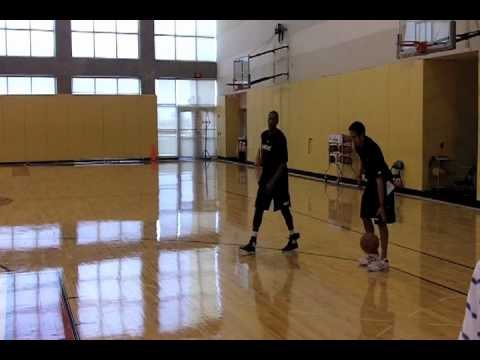 Mario Chalmers works out with Erik Spoelstra