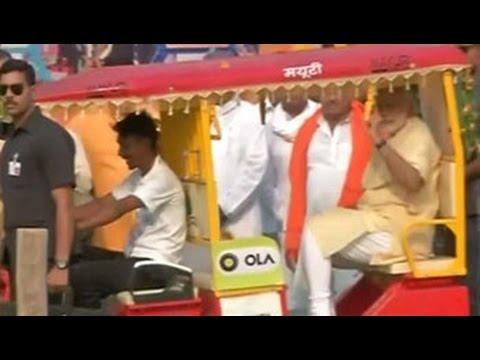 PM Modi on e-drive in Varanasi. first e-rickshaw, then e-boat.