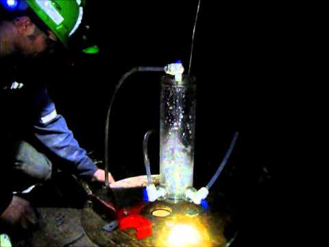 Collecting water samples 2.4km underground