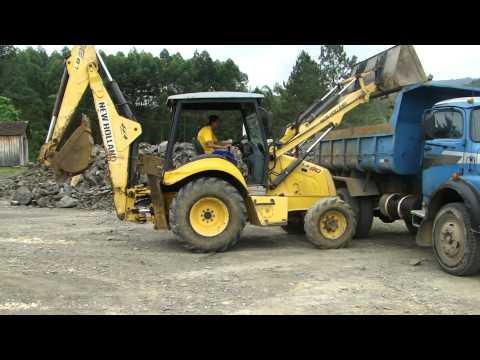W V J Terraplenagem  Fone (48) 9960-9693 Retroescavadeira New Holland LB90