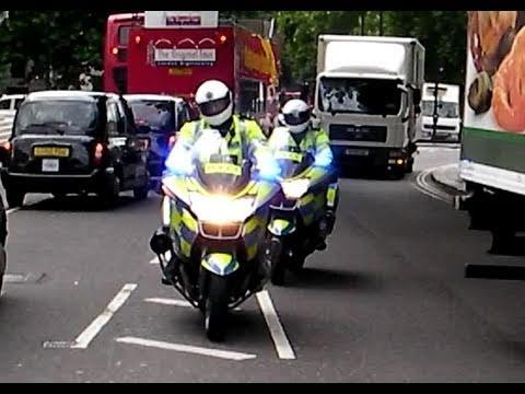 Two London Metropolitan Police BMW R 1200 RT Motorcycles on a Shout