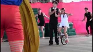 Julia on Unicycle during circus performance at camp
