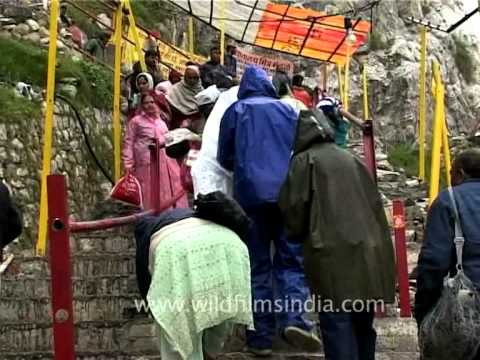 Pilgrims reach up to the Amarnath Holy Shrine