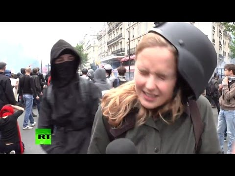 RAW: France anti-labor protester wacks RT reporter upside head during as live