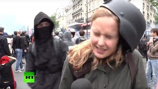 RAW: Protester attacks RT reporter during Paris demo against labor reforms