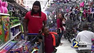 Falcons defensive linemen take kids shopping for Christmas