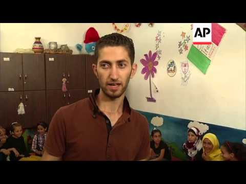 Gaza children take part in play activities to help overcome trauma
