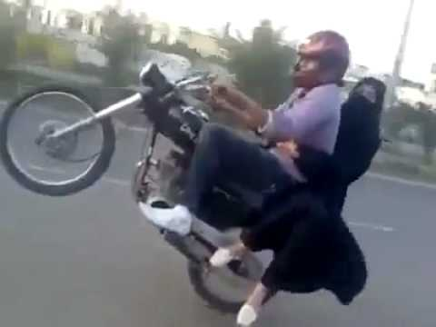Pakistan Bike Wheeling with girl.flv