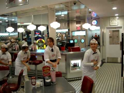 DOWNTOWN TORONTO WAITRESSES DANCING WHILE SERVING DINNER