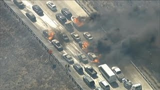 California wildfire torches several cars on major highway