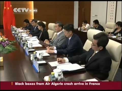 Chinese FM Wang Yi met Canadian counterpart
