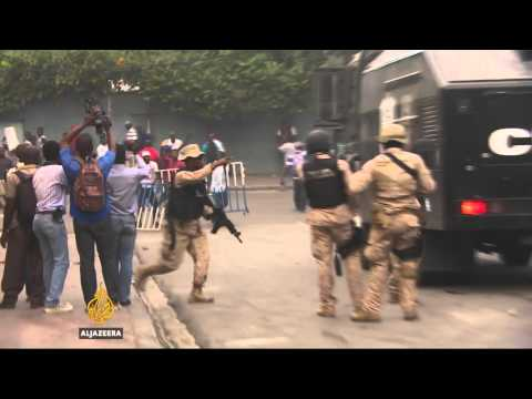 Protests after election postponed in Haiti