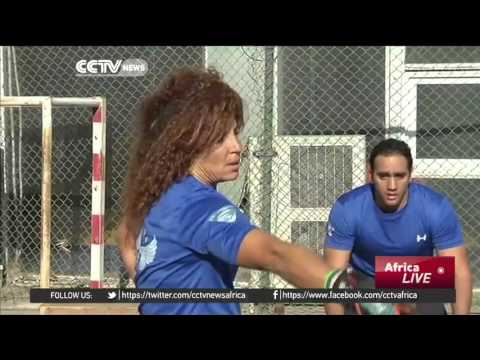 Tennis champion-turned weightlifting coach defies traditions in Cairo