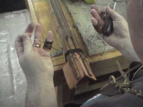 Hand stitching a piece of leather