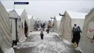 العواصف الثلجية تزيد معاناة اللاجئيين السوريين