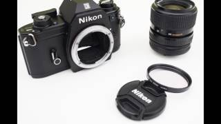 Nikon EM 35mm SLR film camera + Nikon Ai-S Zoom-Nikkor 35-70mm f/3.5-4.8 + UV filter