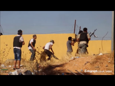 Dramatic video of rival Libyan militias fighting for Tripoli airport