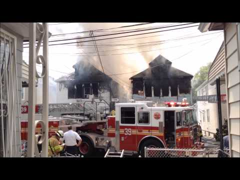 11 firefighters injured battling 4-alarm house fire