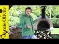 Jamie Oliver shows you how to cook pizza in a wood…