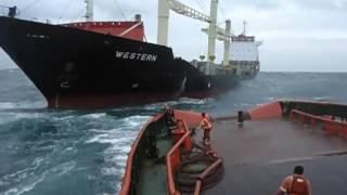 TUGBOAT IN ROUGH SEAS