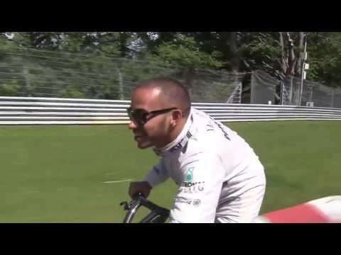 Lewis Hamilton & Nico Rosberg driving electric vehicles