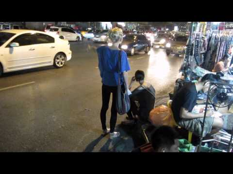 Two young farang girls try to get a taxi in Bangkok , Thailand – time lapse