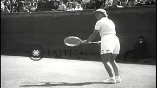 Don Budge takes his fourth national title and Alice Marble wins the women's final...HD Stock Footage